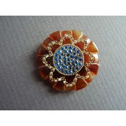 Broche ronde à décor de fleur en strass