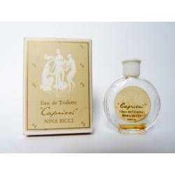 Miniature de parfum Capricci de Nina Ricci flacon montre