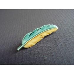 Petite broche plume d'oiseau en métal