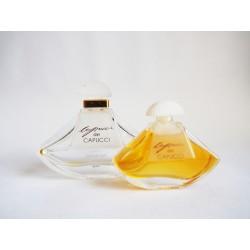 Lot de 2 miniatures de parfum Capucci de Capucci
